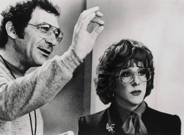 Director Sydney Pollack with Dustin Hoffman on the set of Tootsie.