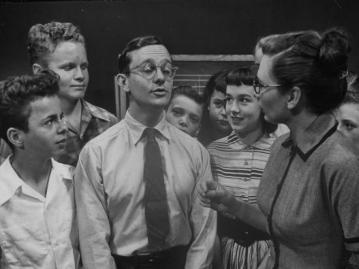 comedian-wally-cox-making-a-cocky-facial-expression-at-the-teacher_u-l-p76mjw0